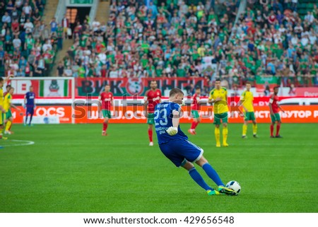 MOSCOW - MAY 11, 2016: Goalkeeper Alexander Belov (23) in action during the soccer game Russian Premier League Lokomotiv (Moscow) vs Kuban (Krasnodar), the stadium Lokomotiv Moscow, Russia - stock photo