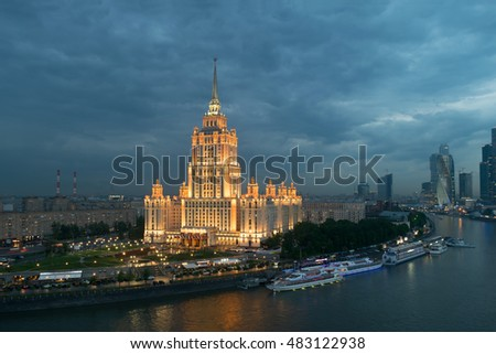 MOSCOW - MAY 22, 2015: Illuminated Royal Hotel Radisson near river at evening, Central volume of building includes 34 floors, Total area of over 88 thousand square meters, height - 206 m
