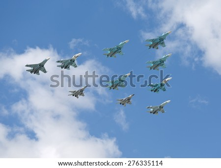 MOSCOW - MAY 7: Jet fighters fly at last rehearsal of the parade dedicated to 70th anniversary of the victory in the Second World War in Red Square on May 7, 2015 in Moscow - stock photo