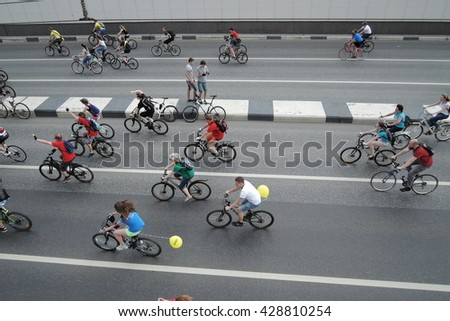 MOSCOW - MAY 29, 2016: Many people ride bikes in Moscow city, on Sadovoye koltso (Garden ring). They participate in a free public bicycle race.