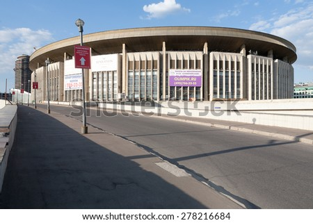MOSCOW - MAY 12: Olympic Stadium in Olympic Avenue on May 12, 2015 in Moscow. Olympic Stadium, known locally as Olimpiyskiy or Olimpiski, is a large indoor arena, located in Moscow, Russia. - stock photo