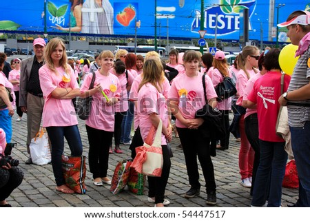 MOSCOW - MAY 29: Participants and guests celebrate after the final ceremony speeches at Avon Walk for Breast Cancer at Red Square on MAY 29, 2010 in Moscow, Russia - stock photo