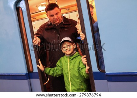 MOSCOW - MAY 5, 2015: People photographed in the doorway of an old subway car at the exhibition of retro-cars dedicated to the 80th anniversary of the Moscow Metro. Public-event - stock photo