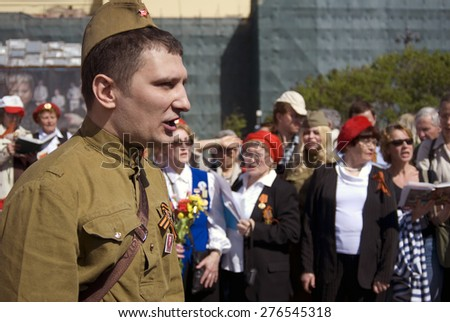 MOSCOW - MAY 09, 2015: People sing war songs on Theater Square in Moscow. Victory Day celebration in Moscow.