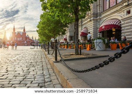 MOSCOW - MAY 16: People sitting in a street cafe on the Red Square near GUM with Historical Museum on the background on May 16, 2014 in Moscow. Red square recognized as a UNESCO World Heritage Site. - stock photo