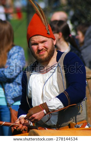 MOSCOW - MAY 02, 2015: Portrait of a man in historical costume in Kolomenskoye park, Moscow. Kolomenskoye is a popular touristic landmark in Moscow.