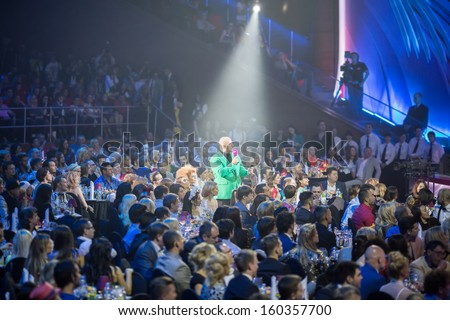 MOSCOW - MAY 25: Presenter Potap speak in microphon among spectators on Russian Music Award channel RUTV in Crocus City Hall on May 25, 2013 in Moscow, Russia. - stock photo