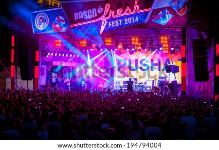 MOSCOW - MAY 24: Pusha T group performs at Bosco Fresh Festival in Muzeon Park on May 24, 2014 in Moscow. The mission of this festival is to find new talent and releasing them on the big stage. - stock photo