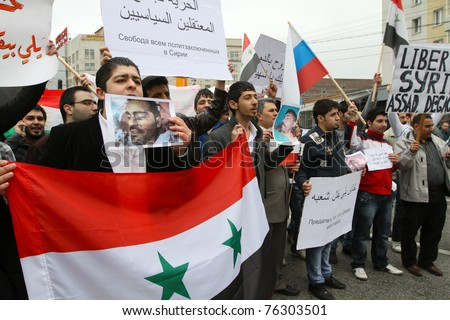 MOSCOW - MAY 1: Rally of representatives of Syrian community on Kaluzhskaya Square where communists gather before the Labor Day march in central Moscow, May 1, 2011 in Moscow, Russia. - stock photo