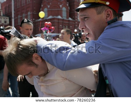 MOSCOW - MAY 28: Russian police detain a gay rights activist during an attempt to hold the unauthorized gay pride parade on May 28, 2011 in Moscow, Russia. - stock photo