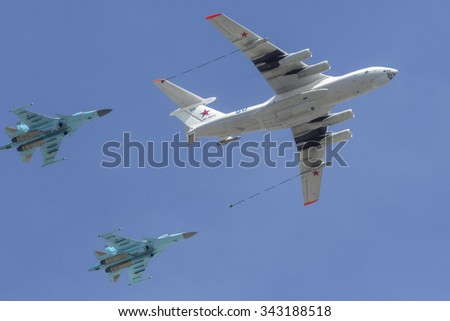 MOSCOW,07 MAY,2015: Russian Su-34 fighter bombers  and a Russian Il-78 aerial refueling tanker fly above the Red square in Moscow during a rehearsal for the Victory Day military parade
