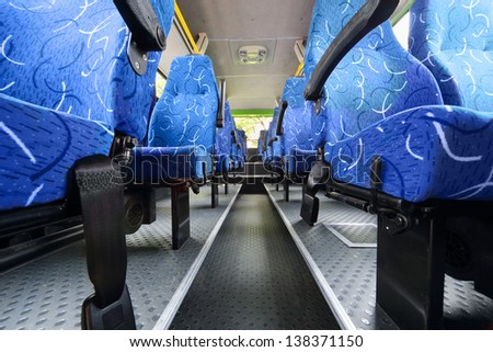 MOSCOW - MAY 15: Seats in saloon of empty city bus at Electrotrance exhibition at VVC, on May 15, 2012 in Moscow, Russia. Electrotrance exhibition at VVC 2012 was attended by 65 companies. - stock photo