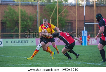 MOSCOW - MAY 13: Some players in action at rugby Russian Rugby Championship 2014 match between Slava CSP (yellow) and Metallurg (black), score 20-13, on May 13, 2014, in Moscow stadium Slava Russia.
