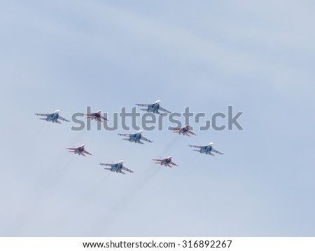 Moscow - May 9, 2015: SU-27 and MIG-29 draw aerobatics diamond in the sky over Red Square May 9, 2015, Moscow, Russia