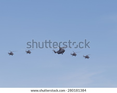 Moscow - May 7th, 2015: military helicopters Mi-26 and Mi-8 formation flying against a blue sky 7, 2015, Moscow, Russia - stock photo