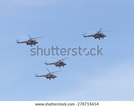 Moscow - May 7th, 2015: military helicopters Mi-8 formation flying against a blue skyMay 7, 2015, Moscow, Russia - stock photo