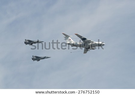 MOSCOW - MAY 9: Two bombers SU-34 and refiller IL-78 on parade devoted to 70th anniversary of victory in the Great Patriotic war on May 9, 2015 in Moscow. - stock photo