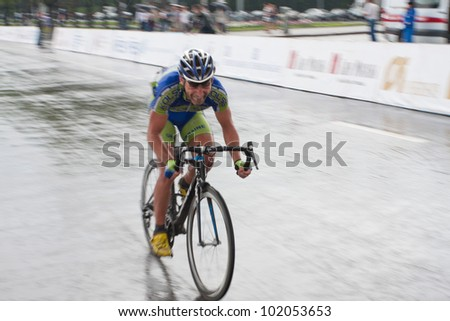 "MOSCOW - MAY 8, 2012: Unidentified cyclists during the ""Five rings of Moscow"" cycling street race in Moscow on May 8, 2012"