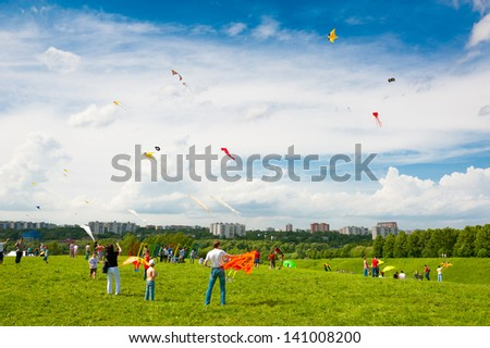 MOSCOW - MAY 25: Unidentified people fly kites at the kite festival in the park Tsaritsyno on May 25, 2013 in Moscow. - stock photo