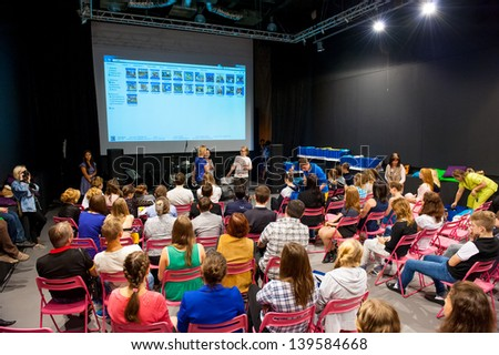 """MOSCOW - MAY 22: Unidentified people listen to speech at graduation """"Colours of Life"""" in MOD gallery on May 22, 2013 in Moscow. - stock photo"""