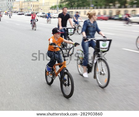 "MOSCOW - MAY 31: Unidentified people ride bicycles at the ""V MOSCOW BICYCLE PARADE"" . Taken on May 31, 2015 in Moscow.   - stock photo"