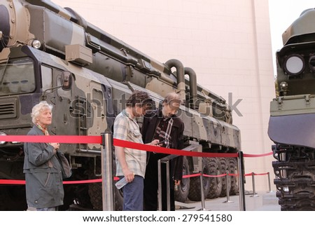 MOSCOW- MAY 13: Unidentified people watching military vehicles Tunguska, S-300 at the VDNH exhibition of war photos, on MAY, 2015 in Moscow.Public-event - stock photo