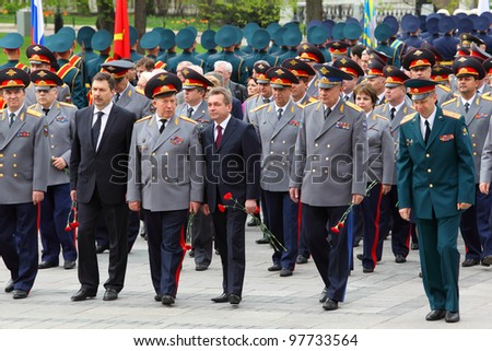MOSCOW - MAY 8: Veterans, officers and State Duma deputies go at ceremony of wreath laying at tomb of Unknown Soldier at Victory Day celebrations, on May 8, 2011, Moscow, Russia. - stock photo
