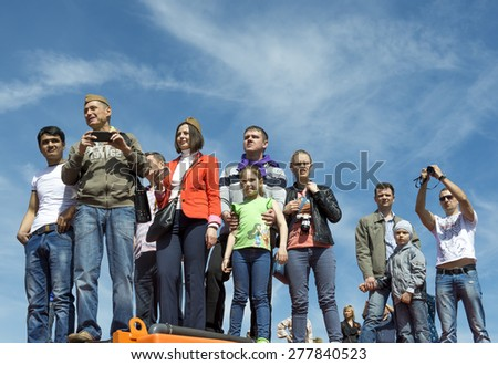 MOSCOW - MAY 9, 2014: Victory day celebrations in Moscow. People watch the parade of military hardware