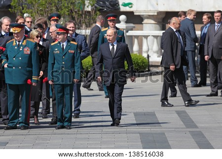 MOSCOW - MAY 8: Vladimir Putin at the ceremony of laying wreaths to the Tomb of the Unknown Soldie. Festive events dedicated to the 67th Anniversary of Victory Day  on MAY 8, 2013 in Moscow, Russia