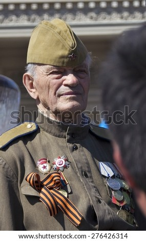 MOSCOW - MAY 09, 2015: War veteran man portrait. Victory Day celebration in Moscow.