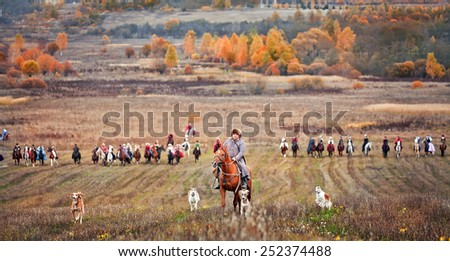"MOSCOW, MOZHAYSK - CTOBER 10, 2014: Historical reconstruction of famous russian hounds hunting by horse club ""Avanpost"" in Mozhaisk, Russia. 4 october 2014 - stock photo"