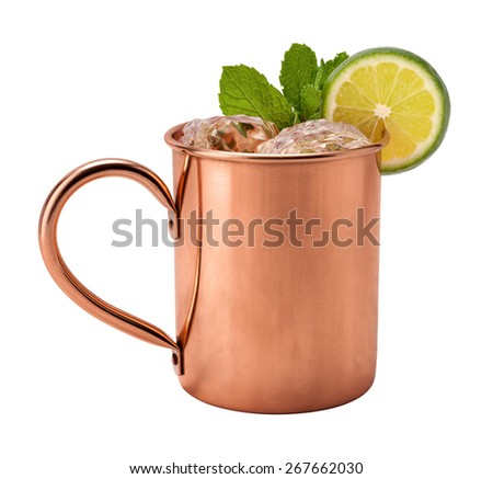 Moscow Mule in a Copper Mug. This is a Vodka drink served with mint, and a garnished with a slice of lime, The image is a cut out, isolated on a white background, and includes a clipping path.  - stock photo