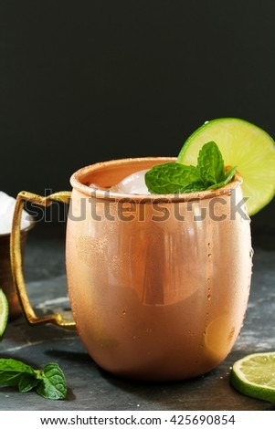 Moscow Mule in a Copper Mug -Vodka drink served with mint and  garnished with a wedge of lime - stock photo