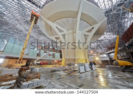 MOSCOW - NOV 29: Articulating booms, scissor and telescopic lifts at construction site of new terminal at Domodedovo Airport, November 29, 2012, Moscow, Russia. - stock photo