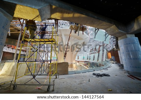 MOSCOW - NOV 29: Construction works on second floor of new terminal at Domodedovo Airport, November 29, 2012, Moscow, Russia. Terminal A has area of 96 thousand sq.m. - stock photo