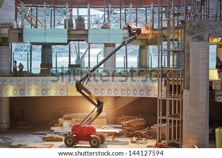 MOSCOW - NOV 29: Welder works at construction of terminal at Domodedovo Airport, November 29, 2012, Moscow, Russia. Domodedovo airport - one of six main airports in Moscow and Moscow region. - stock photo