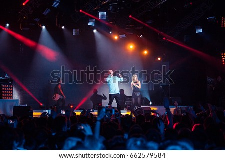 MOSCOW - 30 NOVEMBER,2014: Big hip hop music concert of rap singer L'One.Live entertainment event in nightclub Ray Arena.Famous rapper sing on stage in bright concert lights