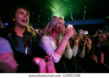 MOSCOW - 30 NOVEMBER,2016: Crowded dancefloor in night club.Full nightclub during musical concert show.People have fun.Entertainment event,fans enjoy music.