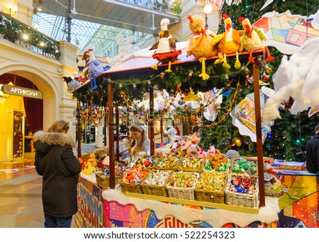 MOSCOW - NOVEMBER 22: Customer near counter at Christmas fair in GUM on November 22, 2016 in Moscow. GUM is large shopping mall in the center of Moscow.