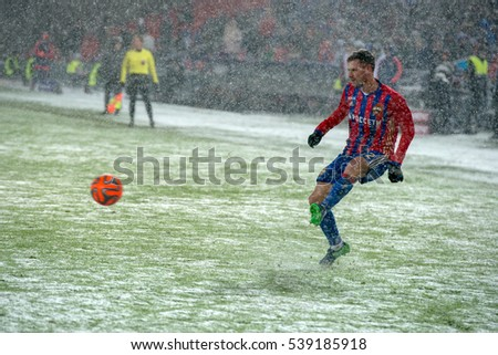 MOSCOW - NOVEMBER 6, 2016: Defender Shennikov George (42) on the soccer game Russian National Football League CSKA (Moscow) vs Amkar (Perm), the stadium Arena CSKA Moscow, Russia. Draw 2: 2