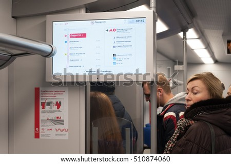 "MOSCOW - NOVEMBER 1: Electronic display, wall banner and passengers at ""Lastochka"" train on Moscow Central Circle (MCC) on November 1, 2016 in Moscow. MCC was opened to passengers on 10 September 2016"