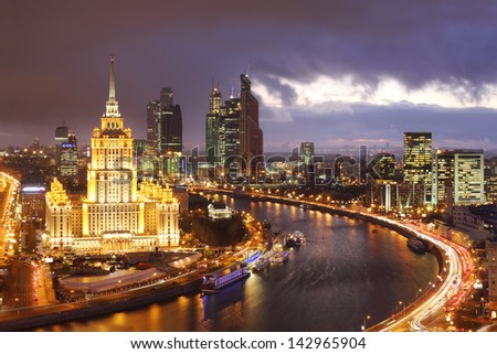MOSCOW - NOVEMBER 13: Hotel Ukraine and Moscow City business complex at evening, on November 13, 2012 in Moscow, Russia. 25 buildings built in Moscow City complex, maximum height - 93 storeys. - stock photo