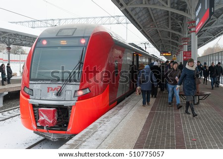 "MOSCOW - NOVEMBER 1: Passengers leaving the train at ""Vladykino"" station of Moscow Central Circle (MCC) on November 1, 2016 in Moscow. MCC was opened to passengers on 10 September 2016."