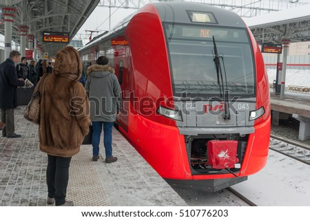 "MOSCOW - NOVEMBER 1: Passengers standing on platform near train at ""Vladykino"" station of Moscow Central Circle (MCC) on November 1, 2016 in Moscow. MCC was opened to passengers on 10 September 2016."
