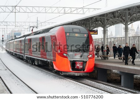 "MOSCOW - NOVEMBER 1: Passengers walking along platform and train at ""Izmaylovo"" station of Moscow Central Circle (MCC) on November 1, 2016 in Moscow. MCC was opened to passengers on 10 September 2016."