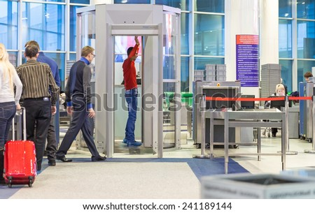 MOSCOW - NOVEMBER 23, 2013: people in the hall of the airport Domodedovo November 23, 2014 in Moscow. Domodedovo airport - the largest and modern airport of Russia - stock photo