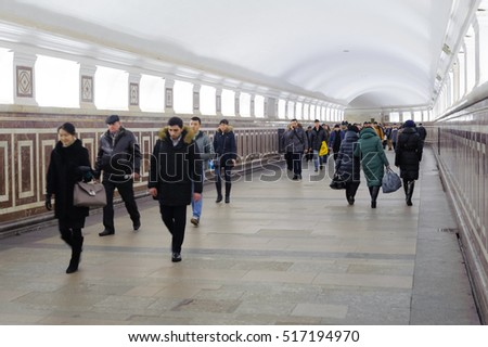 MOSCOW - NOVEMBER 08: People walk along corridor between the Koltsevaya and Arbat-Pokrovskaya lines on November 08, 2016 in Moscow Metro.