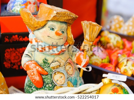 MOSCOW - NOVEMBER 22: Snowman toy on the Christmas fair in GUM  on November 22, 2016 in Moscow. GUM is large shopping mall in the center of Moscow.