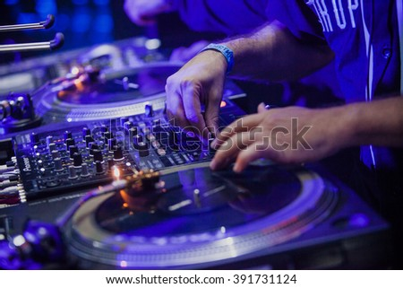 MOSCOW - 22 NOVEMBER, 2015 : Tropkillaz (DJ Laudz & DJ Zegon) play concert in night club.Disc jockey mixing tracks and scratching music records on dj turntable record player on stage,DJ mix tracks