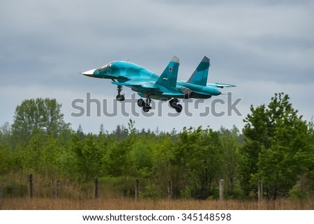 Moscow oblast, Russia - May 18, 2015: Russian bomber Sukhoi Su-34 landing at military airbase.